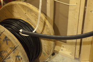 Heliax cable on spool to pull through conduit
